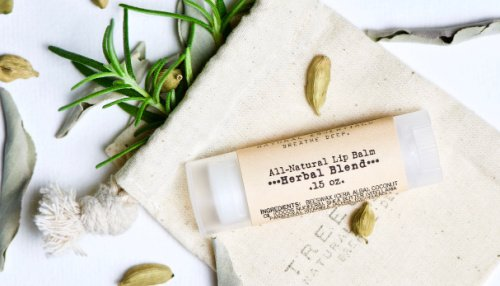 A handmade herbal lip balm made from a diy skin care business
