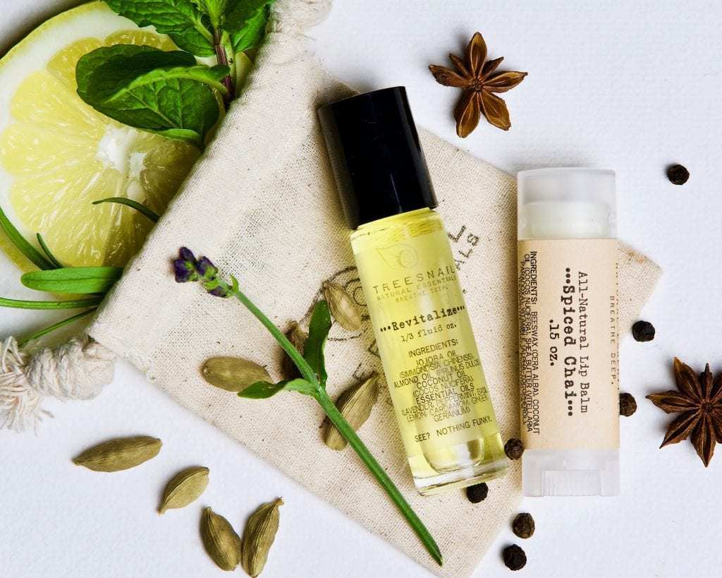 Aromatherapy Roller and organic lip balm set on a cotton muslin bag