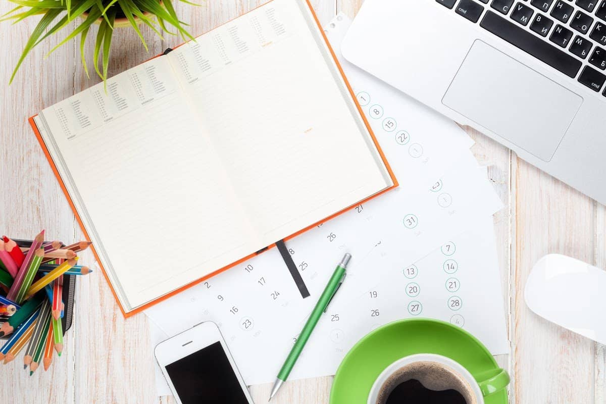 Content calendar, laptop, planners, and coffee