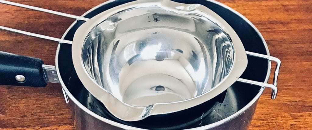 Step 2 of organic lip balm recipe, put doubler boiler on top of sauce pan (bottom touching the water).