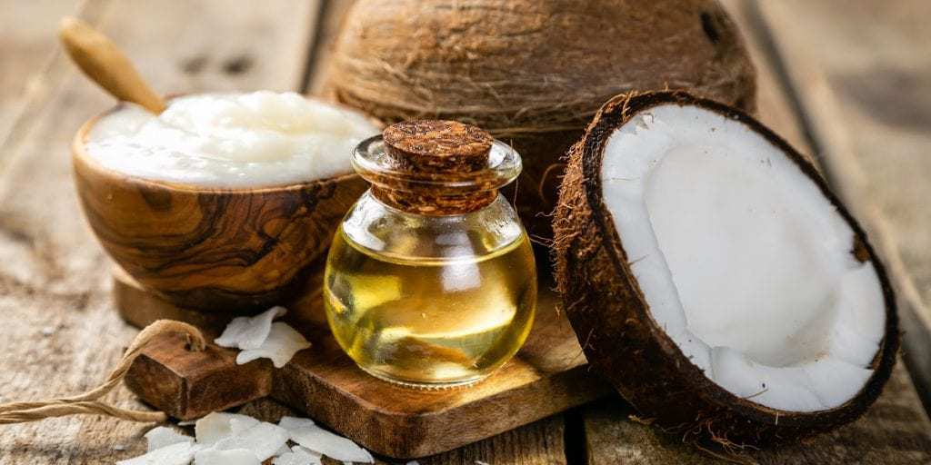 Coconut oil and carrier oil for natural skin care.